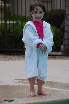 Sydney by the pool teting out her Personalised Bathrobe from Stuck on You. #stuckonyoukids Shop them > www.stuckonyou.biz