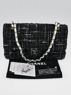 Go in style with this gorgeous Chanel Black Quilted Tweed Classic Medium Double Flap Bag. It features a black quilted tweed blend with a silvertone turnlock CC closure and double flap interior and white leather trim. The versatile leather strap chain can be worn on the shoulder or lengthened to wear with a longer drop. A chic and playful piece to add to any collection.