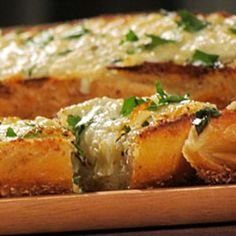Asiago Garlic Bread 1 loaf rustic italian bread, halved lengthwise 1 stick unsalted butter, softened 4 plump garlic cloves 2 Tbsps chopped italian parsley 3/4 cup shredded asiago cheese Combine all ingredients and bake at 350 for 20-30 min.