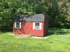 Large storage sheds for all your lawn care allows you to keep your garage open and spacious. Storage Sheds, Traverse City, Lawn Care, Garage, Floor Plans, Real Estate, Outdoor Structures, House, Beautiful