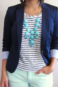 Navy blazer, striped tee, statement necklace, mint jeans (white jeans would work, too)