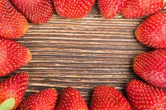 background beautiful strawberries lying around the board in the of a