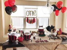 Planning a lumberjack party theme for your baby's birthday? Here's a breakdown of what we purchased and made to put together our son's first birthday lumberjack bash.