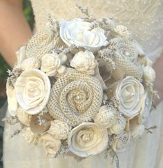 Rustic Cream Ivory Bride's Alternative Wedding Bouquet - Sola Wood, Wildflowers, Vintage Paper Flowers, Fabric  Flowers, Burlap Rosettes. $115.00, via Etsy.