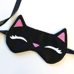 Restful eyes adorn this cute kitty eye mask! Stitch everything in-the-hoop, then turn, and sew closed!
