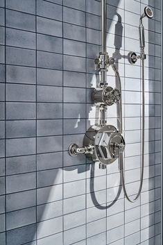 A play on industrial controls from the early 1900s, when pride was lavished on parts. Translated to handcrafted, fittings project rugged beauty through powerful, detailed shapes. Classic Bathroom, White Bathroom, Shower Rose, Bathroom Cabinetry, Contemporary Bathroom Designs, Waterworks, Shower Systems, Bath Rugs, Bathroom Accessories