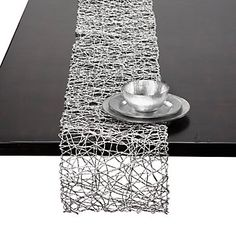 Add some shine to your holiday table with a Silver Nest Runner, $29.95