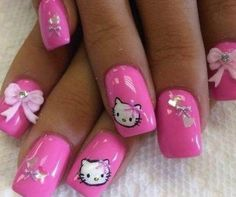Be blown away in pink with this overly cute and girly Hello Kitty nail art design. The look features a plain pink background adored with pink bows in all sizes. Of course to top it off are Hello Kitty's cute faces painted candidly across the nails.