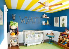 The yellow ceiling stripes in this nursery make our hearts skip a beat!  #baby #nusery