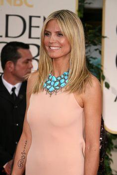 I love Heidi Klum's turquoise statement necklace. I need one like this! #turquoise