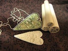 making a mold with rubber stamps  http://rstapestry.typepad.com/rubber_stamp_tapestry/2011/04/natures-path-pendant.html