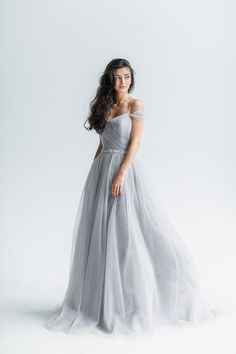 Trudy wedding dress is made of tulle draped dusty gray hue beautifully accentuate the figure of any bride. Open in the shoulders, slightly fitted