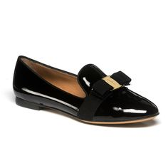 This elegant smoking slipper features the signature Ferragamo bow, careful Italian construction, and a beautifully sculpted smoking slipper shape.