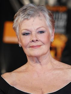 I am thinking when my hair turns grey/white I would like to wear it short, just like Dame Judi Dench.  Classy.
