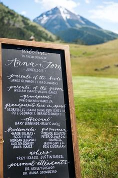 Wedding welcome sign idea - ceremony program on framed chalkboard sign with elegant calligraphy {Lauren Brown Photography}