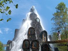 MAGIC MOUNTAIN HOTEL. WHERE GUESTS STAY WHILE THEY ENJOY THE HUNTING AND FISHING RESOURSES OF THE HULIO HULIO RESERVE WITH A WATERFALL CASCADING FROM THE PINNACLE OF THE ROOF THE LODGE IS A SPECIAL PLACE