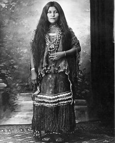 Chiricahuah Apache prisoner of war Isabelle Perico Enjady in a puberty dress, Fort Sill, Oklahoma. 1886-1914