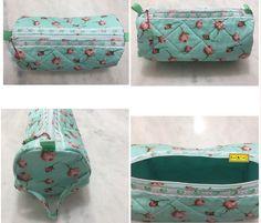 Floral Porta lingerie acolchoado feito de composê de tecidos de algodão floral e verde de poá branco, alça para mão, detalhe de renda branca e fita de cetim verde, zíper com puxador de miçangas. Tamanho: 13cm de diâmetro / 30cm de comprimento. Mais em: arteestiloartesanato.wix.com/site