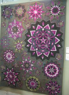 This quilt is absolute gorgeous! Also here: http://www.flickr.com/photos/movinghands/5378998628/