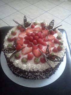 My Fresh cream sponge cake decorated with fruits & chocolate butterflies & sprinkles.
