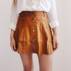 • Bridget Camel Suede Skirt Really cute suede skirt in gorgeous camel color. 90% Polyester, 10% Spandex. *Modeling size Small*  ☑️ NO trades. Price is FIRM unless bundled. ☑️ Sizes Available: Small, Medium, and Large.  *White lace-up blouse is also available for purchase* Skirts Mini