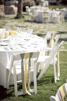 Another great look with ribbons on the back of chairs. Simple and Elegant!