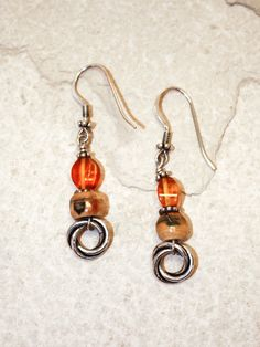"""Handmade ancient mammoth ivory bead earrings, set with sterling silver hooks, and smaller amber bead. Size: 2""""H Including Hook  Price: $45.00 -- on ScrimshawGallery.com #jewelry #earring #ivory"""