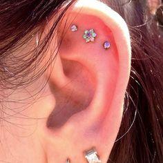 Read about cartilage ear piercing earrings Triple Ear Piercing, Flat Piercing, Piercing Tattoo, Cute Piercings, Body Piercings, Cartilage Piercings, Tongue Piercings, Rook Piercing, Tragus