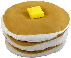 Pancakes Shaped Pillow -- wacko, but bet my nephew would love it. I'll have syrup with mine!