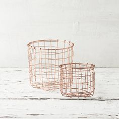 """A simple shape and copper finish make this wire basket an elegant choice for organization or planting.- Copper- ImportedSmall: 4.5""""H, 5"""" diameterLarge: 6.5""""H, 7"""" diameter"""