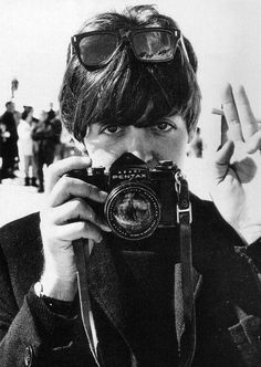 Paul McCartney with a camera black and white