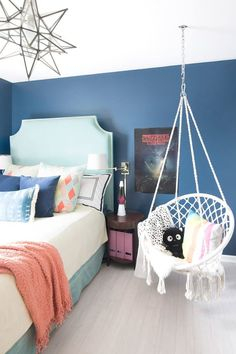 Fun teenage girl bedroom with dark blue walls stranger things poster turquoise headboard macrame hanging chair .