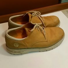 Timberland men's tan work shoes These are structurally gently worn but physically looking they do need cleaned up a little. They are perfect work shoes and still have a ton of wear left in them. Timberland Shoes