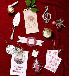 Distinctive Gift Tags  Think outside the gift box and use little kitchen knickknacks and collectibles for personalized Christmas gift tags. Serve up a unique label using an old cheese knife (upper left corner) or tag a vintage candy mold (bottom center) with the recipient's monogram for someone with a sophisticated sweet tooth.