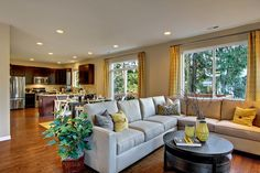 open plan layout of kitchen, dining and living spaces, plus love the peninsula bar
