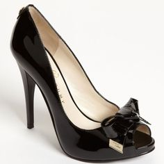 """IVANKA TRUMP black floria pump Brand new, with box.                                                 Golden accents polish a patent, peep-toe pump set atop a slim heel. Approx. heel height: 4 3/4"""". Patent leather upper/synthetic lining and sole. By Ivanka Trump; imported. Women's Shoes. Ivanka Trump Shoes Heels"""