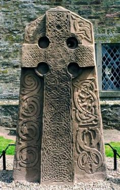 A Pictish cross lab in Aberlemno churchyard, Tayside, Scotland, featuring intricate knotwork and animal motifs.