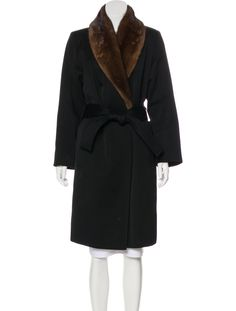 Black Yves Saint Laurent vintage knee-length coat with mink fur collar, dual seam pockets and sash tie closure at waist. Unfortunately, due to restrictions, this item cannot be shipped internationally.