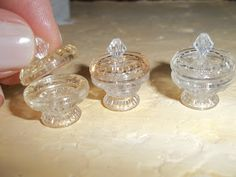 Picture tutorial on how to make miniature candy dishes, pastry stands and cake plates using push pins and glass buttons