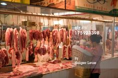 Type of market and meat buying experience that Mama Tang was used to in China... background on the grocery scene.