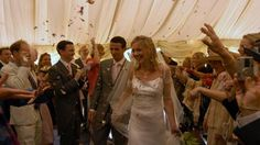 The happy couple are greeted at a wedding reception at Wimpole Hall© Stephen Widdows Photography