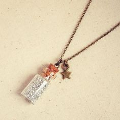 Little Glass Bottle Necklace with Silver Glitter and Tiny Star...oooooh fairy dust in a necklace!