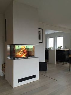 The #Visio #fireplace from #RAIS har a uniqe #design in a #newnordic look. Make your #livingroom #cozy with this fireplace.