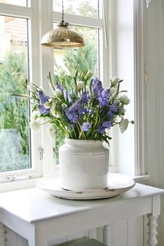Farmhouse Fresh*White Table, Windows, Walls, Beautiful Flowers in Large White Ceramic Container