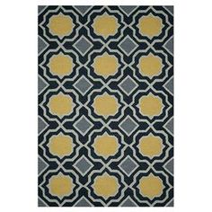 """Anchor your living room or define space in the den with this lovely hand-tufted wool rug, featuring a quatrefoil trellis motif in charcoal and gold. Made in India.     Product: RugConstruction Material: WoolColor: Charcoal and goldFeatures:  Hand-tuftedMade in India  Pile Height: 0.75"""" Note: Please be aware that actual colors may vary from those shown on your screen. Accent rugs may also not show the entire pattern that the corresponding area rugs have.Cleaning and Care: Blot spills. ..."""