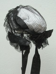 I can't say for certain this was a mourning cap, but black was not a common color for caps except for mourning. It is charming no matter what.