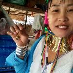 Kayan woman shows the earring she made