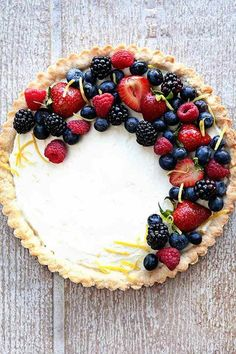 A Lemon Berry Mascarpone Tart is a simple, delicious way to show off all the season's best berries. A Lemon Berry Mascarpone Tart is a simple, delicious way to show off all the season's best berries. 13 Desserts, Delicious Desserts, Plated Desserts, Baking Desserts, Lemon Desserts, Berry Tart, Berry Berry, Slow Cooker Desserts, Sweet Tarts