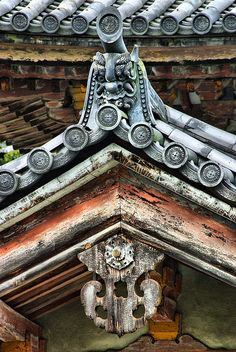 Japanese roof details. I adore the distressed feel of the wood and the bargeboard pendant (gegyo) that is hanging under the kawara