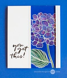 Tutorial Distress Ink Lifting by Jennifer McGuire Ink: White emboss a stamped outline image on white card stock, color paper very generously w/ Distress Ink (here, Blueprint Sketch). Then use a brush to drop water into the petals to soften the color. Use the brush to add other colors (Picked Raspberry & Mowed Lawn). Some Wink of Stella marker adds shimmer. She added faux stitching to the popped up white panels. Stamps: Essentials by Ellen.